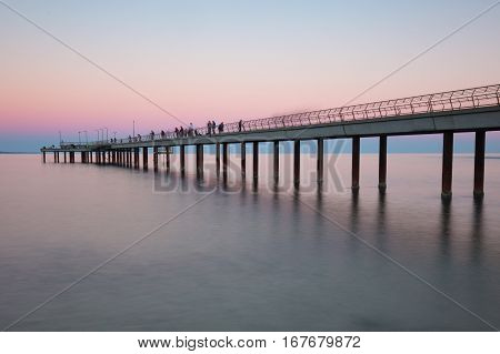 The famous landmark of Lorne Pier at sunset in Lorne, Viictoria, Australia