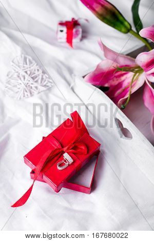 present box and flowers in the bed, lazy morning, valentines day