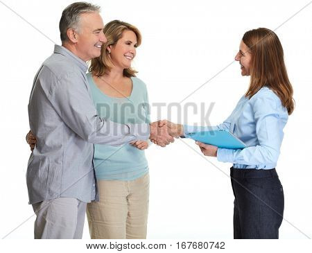 Senior couple with realtor.