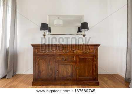 Closer Shot Of Stylish Wooden Commode