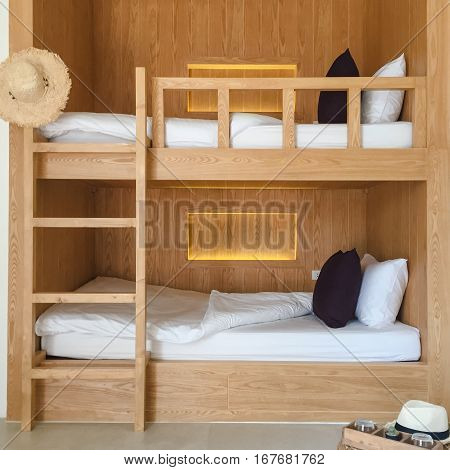 Clean hostel room with wooden bunk beds.