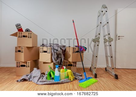 Clean, White Room With Cartons And Cleaning Tools