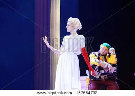 girl in a white wig and covered with white paint.disguised as antique sculpture