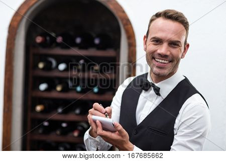 Waiter taking an order in a commercial kitchen
