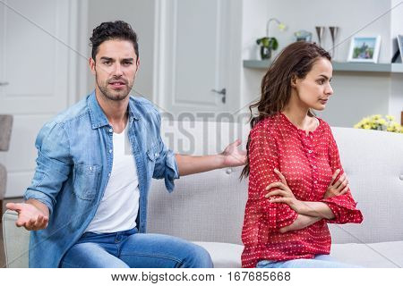 Portrait of man while arguing with woman at home