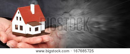 Hand with a little house