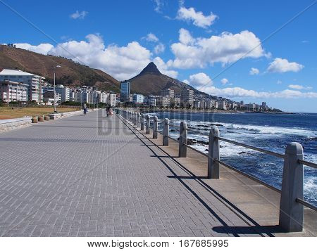 Pathway beside the sea in Cape Town, South Africa. Lion's Head mountain on the background.