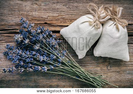 Bouquet Of Dry Lavender Flowers And Sachets Filled With Dried Lavender. Top View. Flat Lay. Retro To