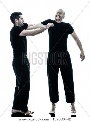 two caucasian men krav maga fighters fighting isolated silhouette on white background