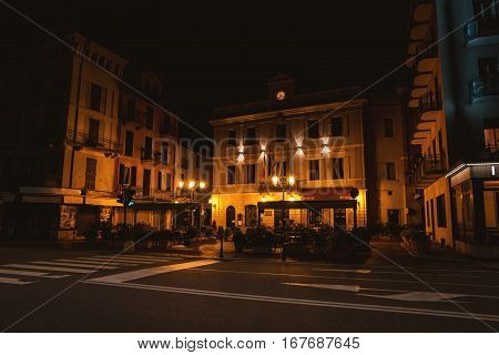 Street of town at night. Facade of building with flags. The foreign embassy.