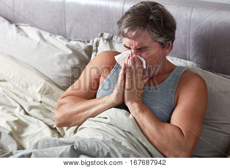 Sick man in bed