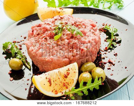 Fresh beef tartar with lemon. Shallow dof.