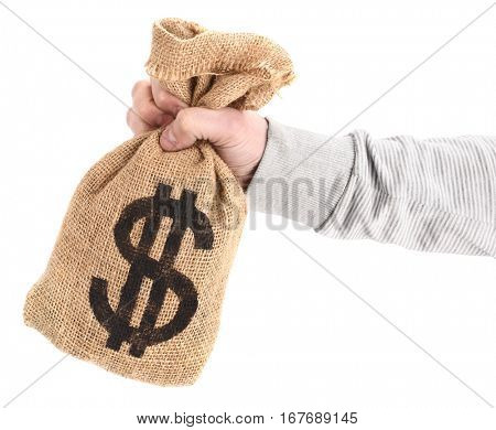 Man's hand is holding burlap sack with dollar money bag