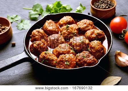 Meatballs in cast iron pan close up view