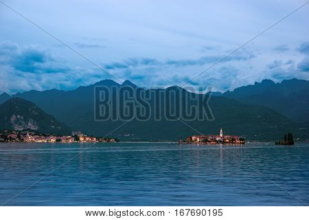 Mountains in the evening. Town lights at distance. Trip to Isola Superiore.