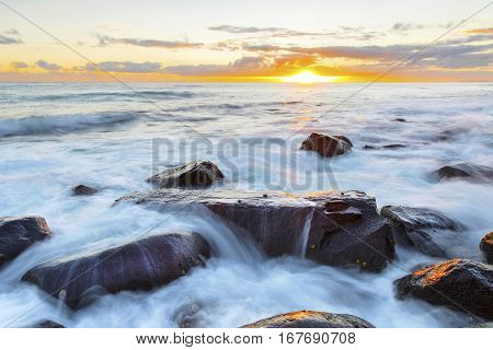 Ocean tide rushing over the rocks at Burleigh Heads Gold Coast