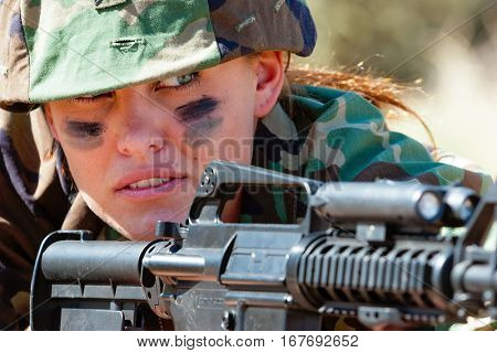 Military army woman holding gun