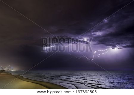 Lightening bolts as the clouds lighten up over the ocean on the Gold Coast