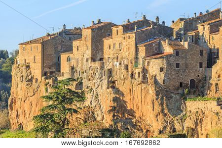 Pitigliano - Etruscan Tuff Town, Italy. In the 6th century BC, Etruscans settlements were arrayed along these hilltops, providing ample defense positions above highly arable land.