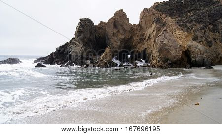 BIG SUR, CALIFORNIA, UNITED STATES - OCT 7, 2014: Huge ocean waves crushing on rocks at Pfeiffer State Park in CA along Highway No 1, USA.