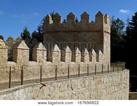 The medieval city walls against vivid blue sky, Avila of Spain