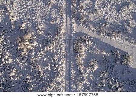 Winter road covered in snow from above