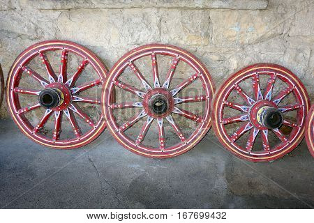 beautiful painted wheels of carts on village