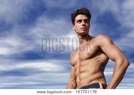 Beautiful and muscular young man shirtless. A beautiful young Italian man posing at the sea, athletic and muscular body.