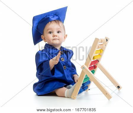 Child dressed in academic clothes with counter. Early learning baby.