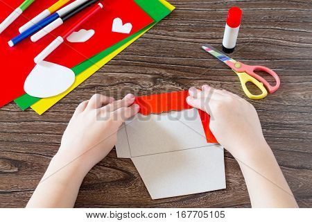 The Child Puts The Details Of Application. Easter Card Chicken Letter Handmade. Children's Art Proje