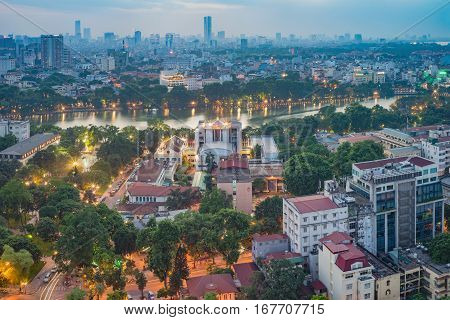 Aerial View Of A Hoan Kiem Lake ( Sword Lake, Ho Guom In Vietnamese ) At Night. Hanoi Skyline View.