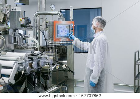 Plant Picture, Scientist Configures Control Panel