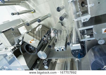big manufacture machine with shafts in pharmaciutical factory