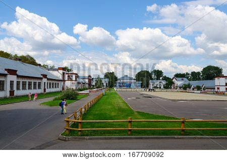 MOSCOW RUSSIA - JULY 23 2016: Unidentified people walk near pavilions
