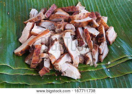 The background of roasted pork on banana leaf