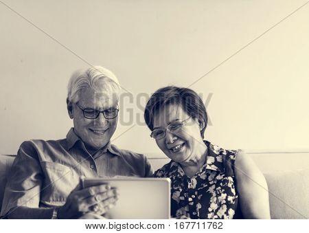 Senior Couple Use Tablet Techie