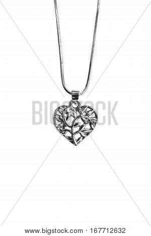 Silver heart pendant hanging on a chain isolated over white