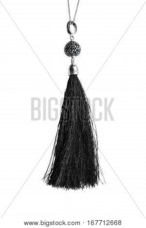 Black silk tassel hanging on a chain isolated over white