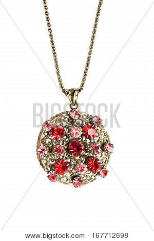 Golden ruby medallion on a chain isolated over white