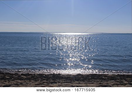ocean horizon line with dappled light on the water