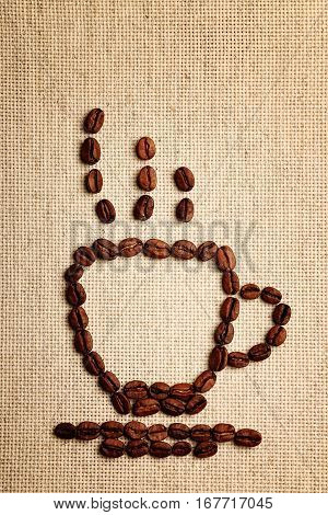Coffee beans on the background of cotton tablecloth