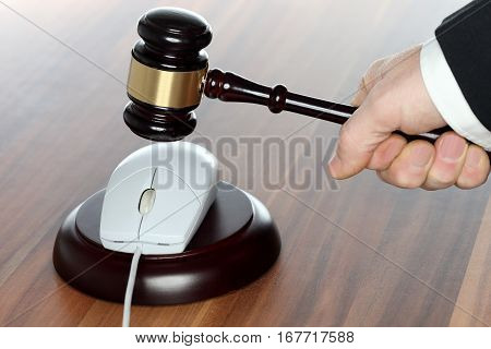 symbolic media law with hammer and computer mouse