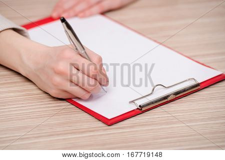 Hand writing memo in business concept