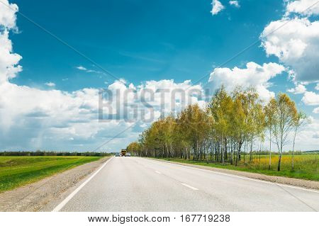 Beautiful Asphalt Freeway, Motorway, Highway Against Background Of Eastern European Landscape. Travel Road And Transportation Concept. Sunnny Day With Blue Sky.