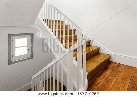 Beautiful Staircase With Hardwood Floor and White Walls