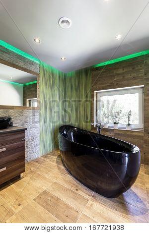 Travertine Bathroom With Black Bath