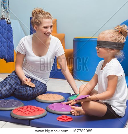 Child With A Band On Eyes During Therapy