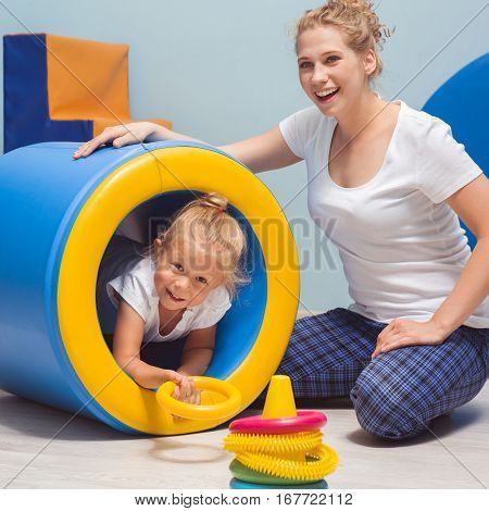 Child Exercising During Occupational Therapy