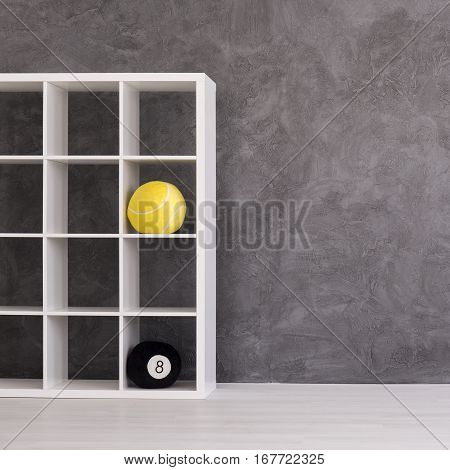 Grey Empty Room With A Bookcase