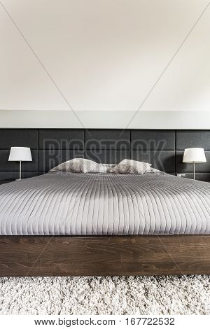 Bed With Grey Duvet